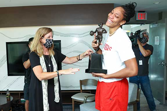 Cathy Englebert presents A'ja Wilson with MVP trophy. Photo by Ned Dishman, courtesy of Getty Images