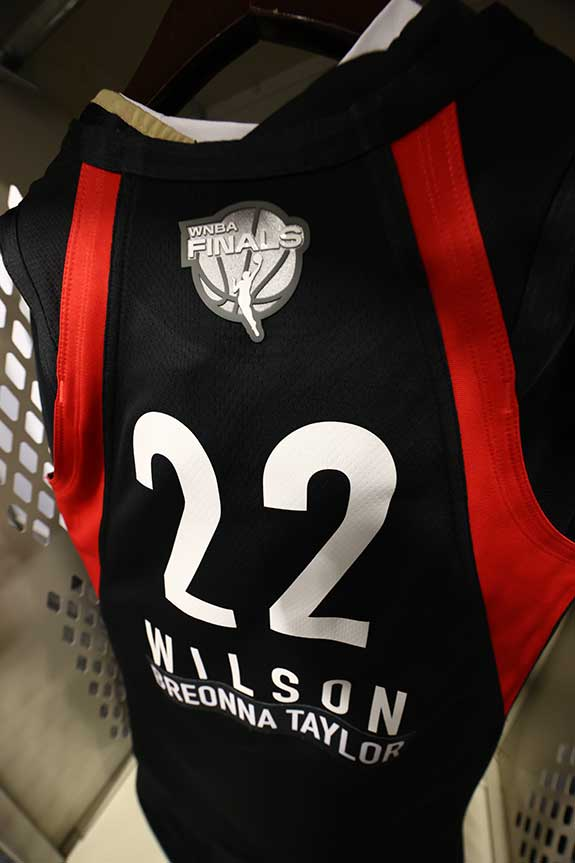 A'ja Wilson jersey hanging in locker at WNBA Finals Game. Photograph by Ned Dishman courtesy of Getty Images