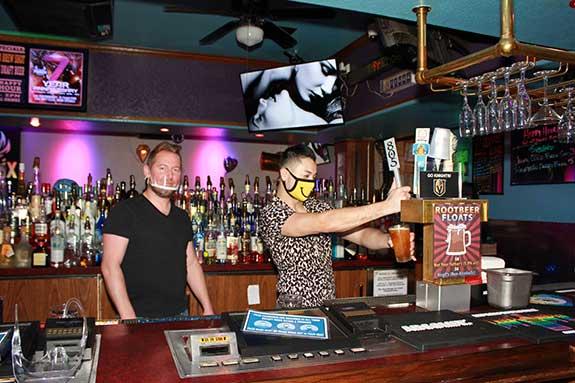 Landon Heins at Bar with Staff