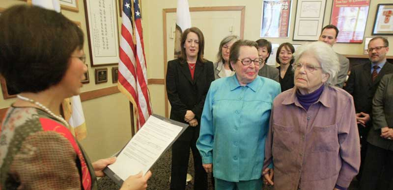 Del Martin and Phyllis Lyon are first lesbian couple to be married in California.